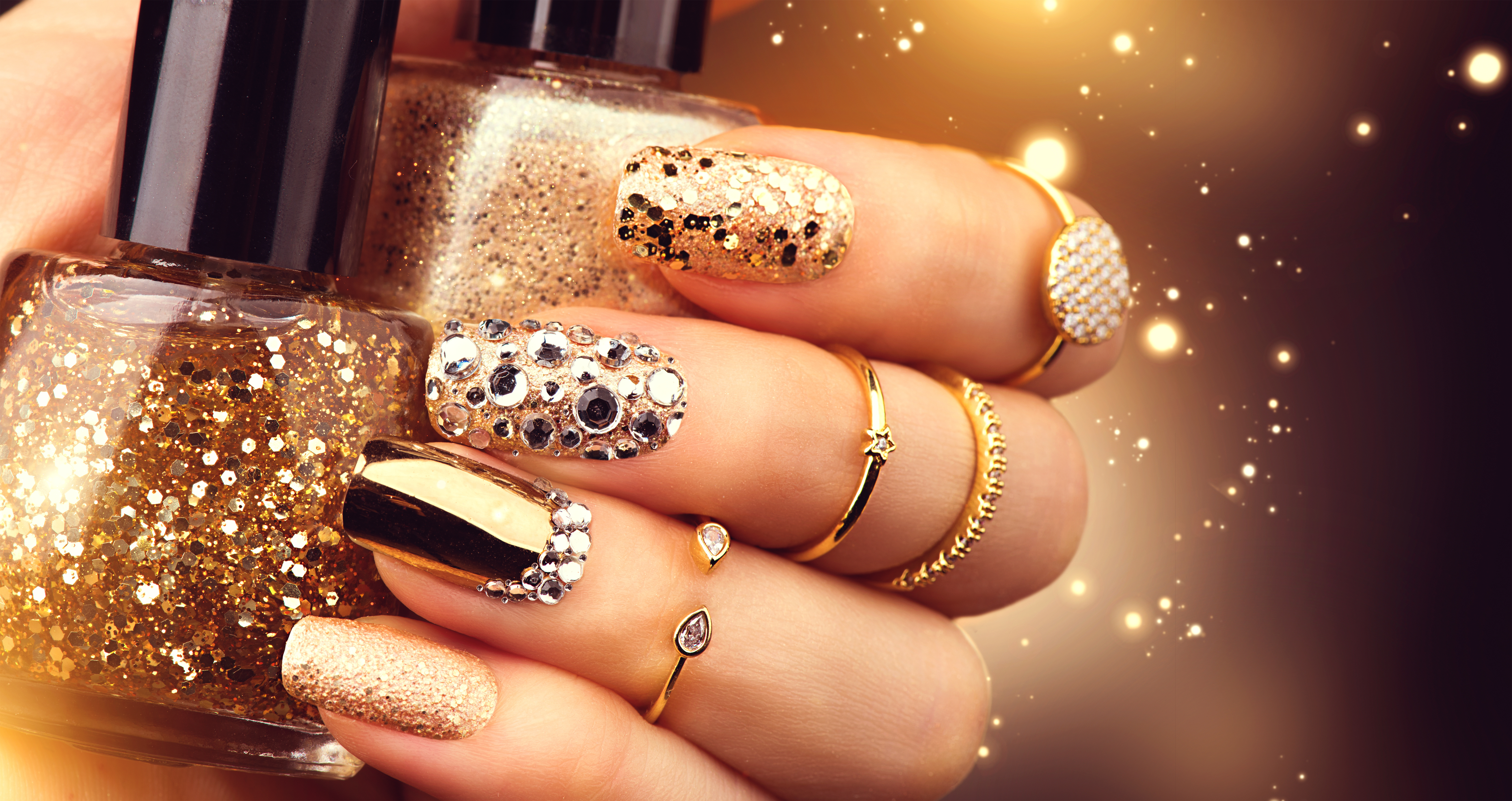 Golden manicure with gems
